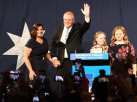Australia's newly elected Prime Minister Scott Morrison (C) arrives to deliver a victory speech with his family after winning the Australia's general election in Sydney on May 18, 2019. - Australia's ruling conservative coalition appeared to secure a shock election win on May 18, with the party predicted to have …