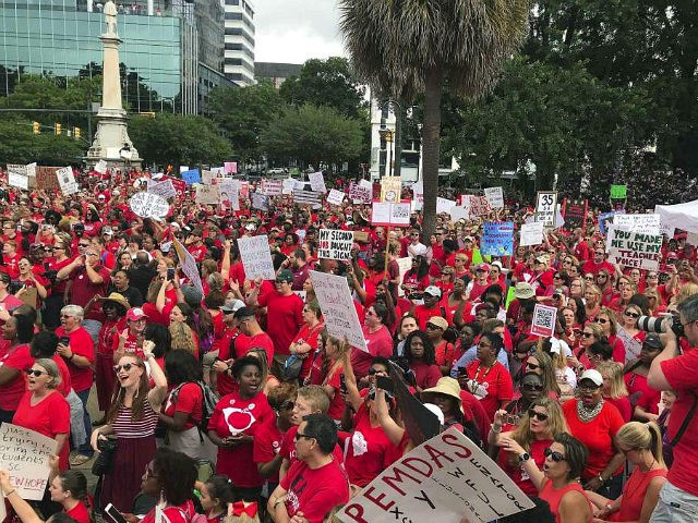 Thousands gather at the South Carolina Statehouse Wednesday, May 1, 2019, for a rally calling on legislators to provide full funding to address classroom sizes, pay raises and the teacher shortages among other concerns from advocates, in Columbia, S.C. The rally prompted at least seven school districts to close. (AP …