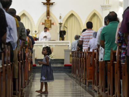 TOPSHOT - Sri Lankan Catholic devotees pray during a mass at the St. Theresa's church as the Catholic churches hold services again after the Easter attacks in Colombo on May 12, 2019. - A Sri Lankan province north of the capital was under indefinite curfew on May 14 after the …