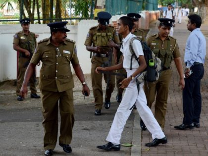 Sri Lankan police stand guard as school students return to classes as schools re-open across the country after the Easter attacks in Colombo on May 6, 2019. - The head of Sri Lanka's Catholic Church appealed for calm on May 6 after sporadic violence between Christian and Muslims north of …