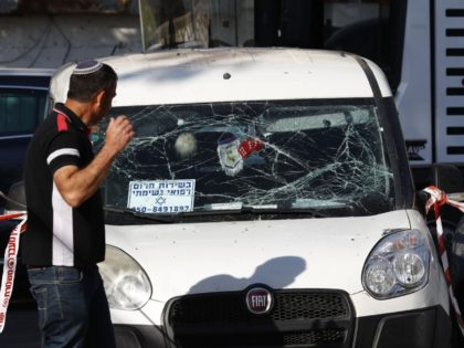 A man walks past a car that was damaged during a rocket strike on the southern Israeli city of Ashkelon near the Gaza border, on May 5, 2019. - Gaza militants fired fresh rocket barrages at Israel early today in a deadly escalation that has seen Israel respond with waves …