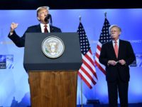 TOPSHOT - US President Donald Trump (C) is accompanied by US Secretary of State Mike Pompeo (L) and US National Security Advisor John Bolton (R) as he addresses a press conference on the second day of the North Atlantic Treaty Organization (NATO) summit in Brussels on July 12, 2018. (Photo …