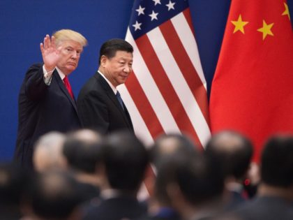 """TOPSHOT - US President Donald Trump (L) and China's President Xi Jinping leave a business leaders event at the Great Hall of the People in Beijing on November 9, 2017. Donald Trump urged Chinese leader Xi Jinping to work """"hard"""" and act fast to help resolve the North Korean nuclear …"""