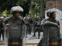 Venezuelan Bolivarian National stand guard around the National Assembly building as the opposition-controlled congress met to discuss a move could provide political cover for greater international involvement in the nation's crisis, in Caracas, Venezuela, Tuesday, May 7, 2019. Military police prevented journalists from entering the National Assembly, and some reporters …