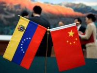The Chinese and Venezuelan flag are polaced on the table where a ceremony to sign agreements between the two nations took place at the Great Hall of the People in Beijing Wednesday, Sept. 24, 2008. Chavez said his country's oil exports to China could soar to 1 million barrels a …