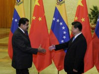 BEIJING, CHINA - SEPTEMBER 1: Chinese President Xi Jinping (R) shakes hands with Venezuela's President Nicolas Maduro before their meeting at the Great Hall of the People September 1, 2015 in Beijing, China. Maduro is visiting China seeking financial assistance as Venezuela has been hit hard by recession. (Photo by …