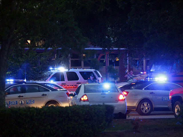 Family members gather outside the Princess Anne Middle School in Virginia Beach, Va, on Friday, May 31, 2019. A longtime city employee opened fire at a municipal building in Virginia Beach on Friday, killing 11 people before police shot and killed him, authorities said. Six other people were wounded in …