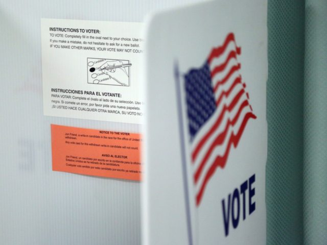 nstructions in both English and Spanish on how to vote are affixed to a booth inside a polling station in Christmas, Florida prior to the arrival of voters on election day, on November 8, 2016. After an exhausting, wild, bitter, and sometimes sordid campaign, Americans finally began voting Tuesday for …