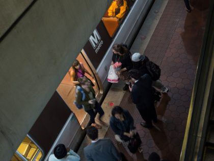 Commuters get off a Metro train as others wait to go aboard at the L'Enfant Plaza station in Washington, DC, on May 24, 2016. Paul Wiedefeld, who used to run the Baltimore-Washington international airport, took over as Metrorail's new general manager in November, assuming what was probably the least wanted …