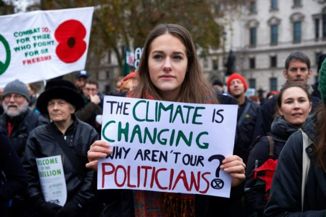 Environmental activists march during a demonstration organised by the movement Extinction Rebellion in central London on November 24, 2018, calling on the British government to take action on climate and ecological issues