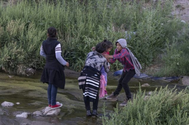Immigrants cross the Rio Grande river between Ciudad Juarez, Mexico and El Paso, Texas, on April 29, 2019