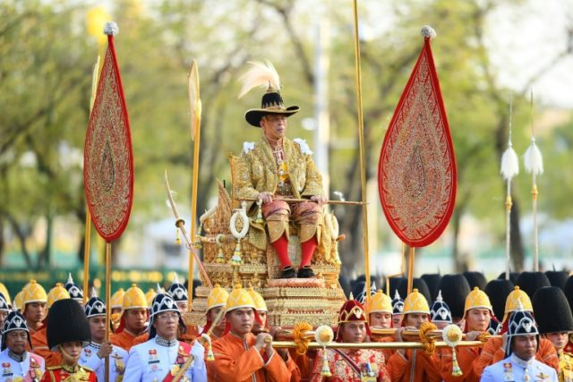 Thailand's King Maha Vajiralongkorn was carried through the streets of Bangkok in a royal procession