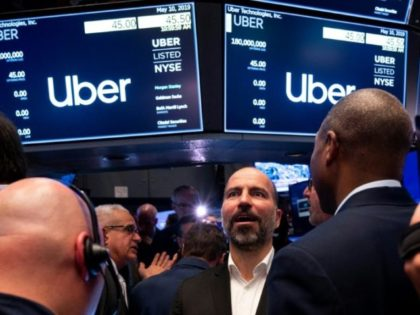 Uber CEO Dara Khosrowshahi talks to traders on the New York Stock Exchange after ringing the opening bell on the first day of trade for the ride-hailing giant