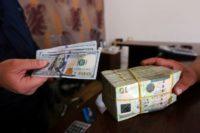 Economic warfare plays out as Libyans battle for capital