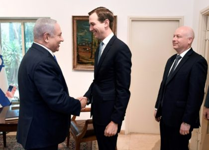 US President Donald Trump's son-in-law and adviser Jared Kushner shakes hands with Israeli Prime Minister Benjamin Netanyahu during a meeting in Jerusalem, with Trump's aide for international negotiations Jason Greenblatt looking on