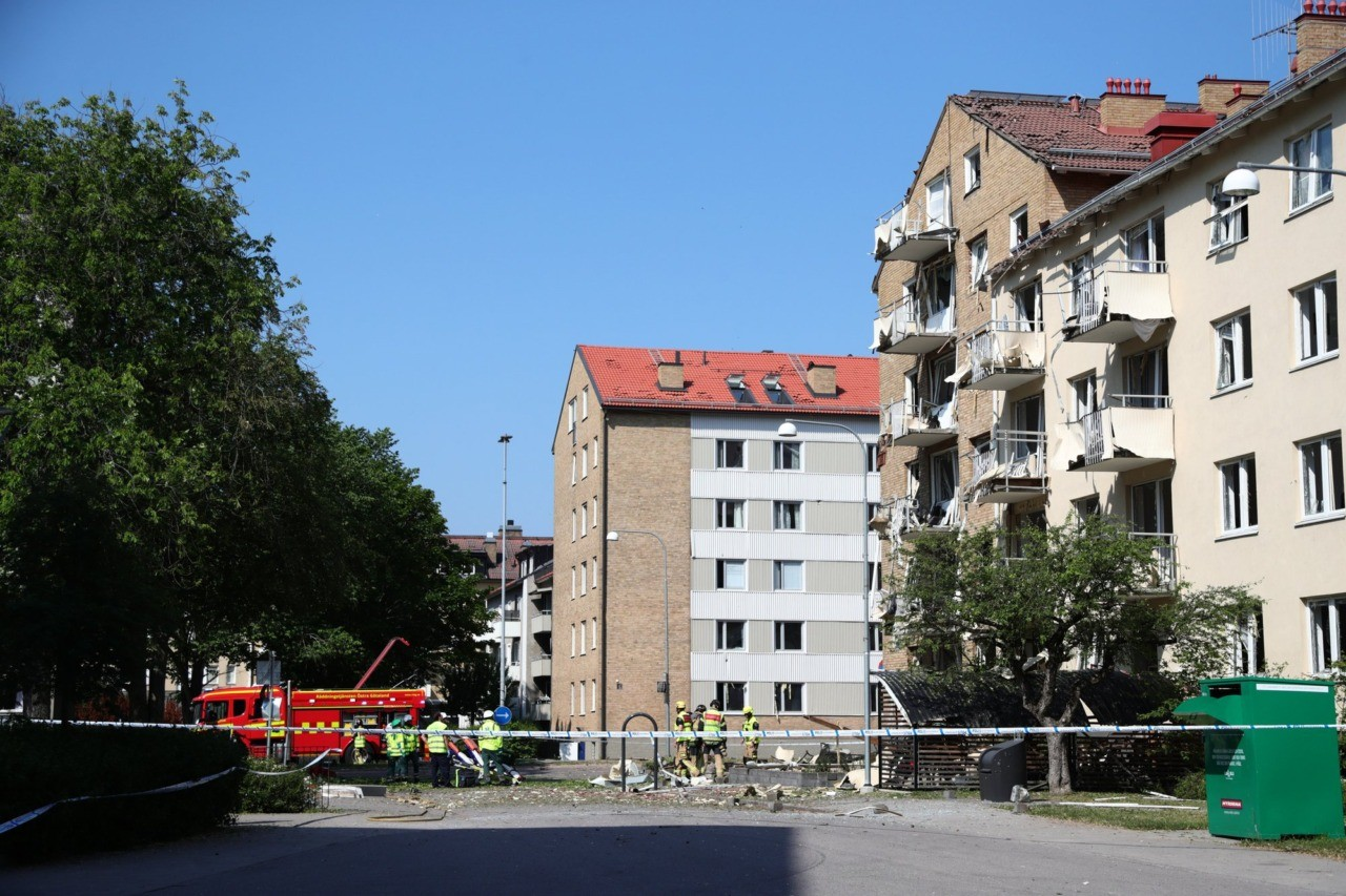 Rescue personnel outside a block of flats that were hit by an explosion, in Linkoping, Sweden, Friday, June 7, 2019. A blast ripped through two adjacent apartment buildings in a southern Sweden city on Friday, police said. There were unconfirmed reports of people with minor injuries. (Jeppe Gustafsson/TT News Agency via AP)
