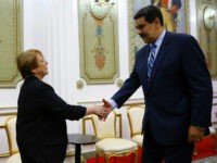 U.N. High Commissioner for Human Rights Michelle Bachelet, left, is greeted by Venezuela's President Nicolas Maduro, at Miraflores Presidential Palace, in Caracas, Venezuela, Friday, June 21, 2019. The United Nations' top human rights official is visiting Venezuela amid heightened international pressure on President Maduro. (AP Photo/Ariana Cubillos)