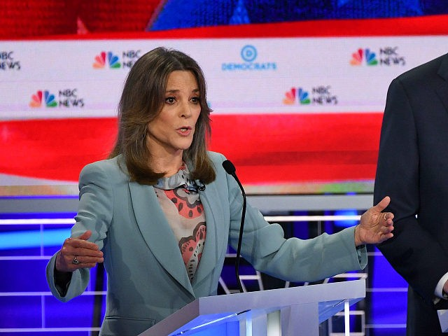 Democratic presidential hopefuls US author and writer Marianne Williamson (L) and Former Governor of Colorado John Hickenlooper (R) participate in the second Democratic primary debate of the 2020 presidential campaign season hosted by NBC News at the Adrienne Arsht Center for the Performing Arts in Miami, Florida, June 27, 2019. …