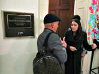 Rep. Alexandria Ocasio-Cortez (D-NY) speaks to a supporter outside of her office in the Cannon House Office Building on Capitol Hill February 14, 2019 in Washington, DC. (Mark Wilson/Getty Images/AFP)