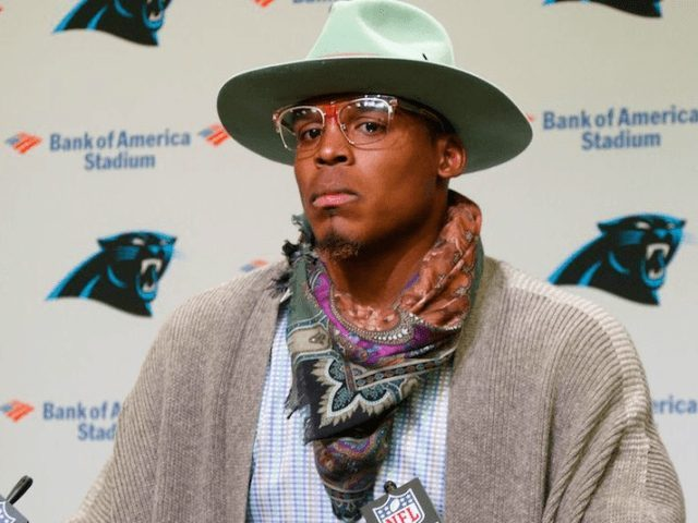 Moment Panthers quarterback Cam Newton offers a passenger $1,500 to swap seats