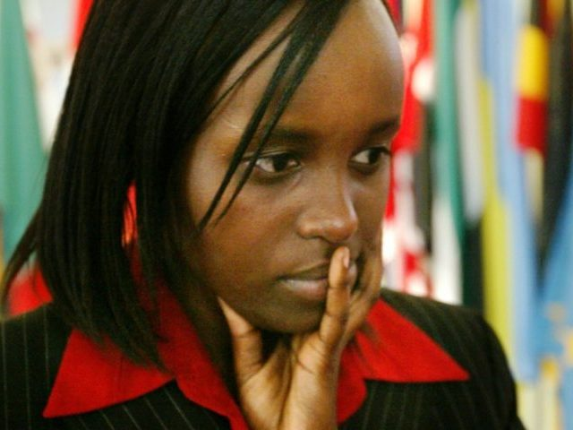 "Jacqueline Murekatete, 19, waits for an interview outside the halls of the General Assembly, after speaking to its members, during the ""International Day of Reflection on the 1994 Genocide in Rwanda"" at the United Nations in New York, Wednesday, April 7, 2004. (AP Photo/Bebeto Matthews)"
