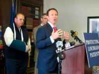 Attorney General Jeff Landry talks about health care legislation supported by House Speaker Taylor Barras, R-New Iberia, left, and sponsored by Sen. Fred Mills, R-Parks, on Monday, April 1, 2019, in Baton Rouge, La. (AP Photo/Melinda Deslatte)
