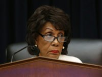 FILE - In this April 10, 2019, file photo, House Financial Services Committee chairwoman Maxine Waters, D-Calif., listens during a hearing with leaders of major banks on Capitol Hill in Washington. After nearly three decades in Waters has become the highest-ranking African American woman in the country. (AP Photo/Patrick Semansky, …
