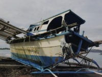 In this undated June 2019 handout photo provided Arlinda dela Torre via the Department of Agriculture, the damaged Filipino fishing boat F/B Gimver 1 lies on the shores at San Jose, Occidental Mindoro province, Philippines. China recently acknowledged its fishing vessel hit a Filipino boat in the disputed South China …