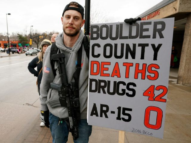 BOULDER, CO - APRIL 21: A man who didn't want to be identified carries his Noveske N4 300 Blackout AR-15 pistol at a pro gun rally on April 21, 2018 in Boulder, Colorado. The city of Boulder is considering enacting an ordinance that will ban the sale and possession of …