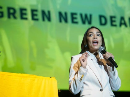 Rep. Alexandria Ocasio-Cortez, D-N.Y., addresses the Road to the Green New Deal Tour final event at Howard University in Washington, Monday, May 13, 2019. (AP Photo/Cliff Owen)