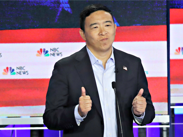 MIAMI, FLORIDA - JUNE 27: Democratic presidential candidate former tech executive Andrew Yang speaks during the second night of the first Democratic presidential debate on June 27, 2019 in Miami, Florida. A field of 20 Democratic presidential candidates was split into two groups of 10 for the first debate of …