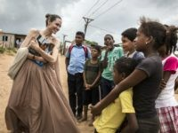 RIOHACHA, COLOMBIA - JUNE 07: (EDITORIAL USE ONLY) In this handout image provided by United Nations High Commission for Refugees, UNHCR Special Envoy Angelina Jolie speaks with children in Riohacha, Colombia, on June 7, 2019. Jolie visited the children, who had fled Venezuela, in Brisas del Norte, an informal settlement …
