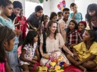 MAICO, COLOMBIA - JUNE 08: (EDITORIAL USE ONLY) In this handout image provided by United Nations High Commission for Refugees, UNHCR Special Envoy Angelina Jolie meets with children who fled Venezuela, at the Integrated Assistance Centre on June 8, 2019 in Maicao, Colombia. The Integrated Assistance Centre provides integrated assistance …