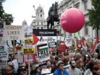 LONDON, ENGLAND - JUNE 04: A crowd of protesters during a demonstration on Whitehall during the second day of U.S. President Donald Trump's State Visit on June 4, 2019 in London, England. President Trump's three-day state visit began with lunch with the Queen, followed by a State Banquet at Buckingham …