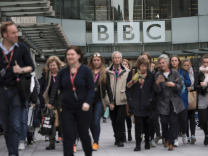 LONDON, ENGLAND - MARCH 25: People walk past Broadcasting House, the headquarters of the BBC, on March 25, 2014 in London, England. MPs have today voted in favour of an amendment to the Deregulation Bill which, if passed, will require the Government to conduct a review of punishments for non-payment …