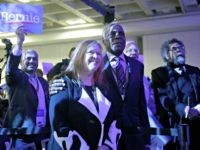 Jane O'Meara Sanders, the wife of Democratic presidential candidate Sen. Bernie Sanders, I-Vt., center left, stands with actor Danny Glover during the 2019 California Democratic Party State Organizing Convention in San Francisco, Sunday, June 2, 2019. (AP Photo/Jeff Chiu)