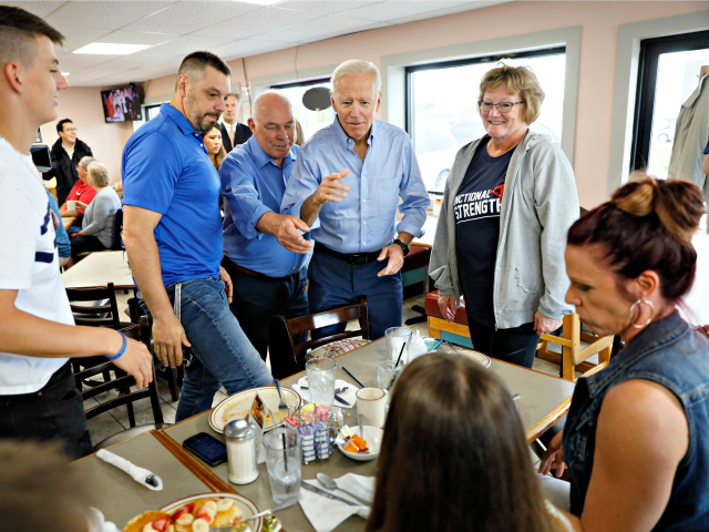 Democratic presidential candidate former Vice President Joe Biden visits with local diners during a stop at the Tasty Cafe, Wednesday, June 12, 2019, in Eldridge, Iowa. (AP Photo/Charlie Neibergall)
