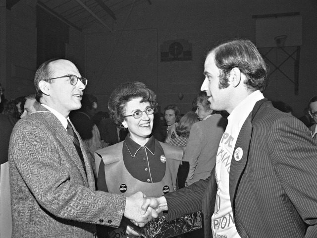 Sen. Joseph Biden, D-Del., right, shakes hands with Adlai E. Stevenson III, D-Ill., April 6, 1974, during the first annual Counter Gridiron party in Washington. Watching is Miss Ruth Dean of Washington. (AP Photo)
