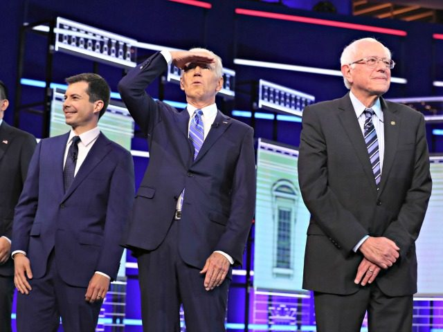 MIAMI, FLORIDA - JUNE 27: Former Vice President Joe Biden (2nd-R), Sen. Bernie Sanders (I-VT) (R), South Bend, Indiana Mayor Pete Buttigieg (2nd L), and former tech executive Andrew Yang walk on stage during the second night of the first Democratic presidential debate on June 27, 2019 in Miami, Florida. …