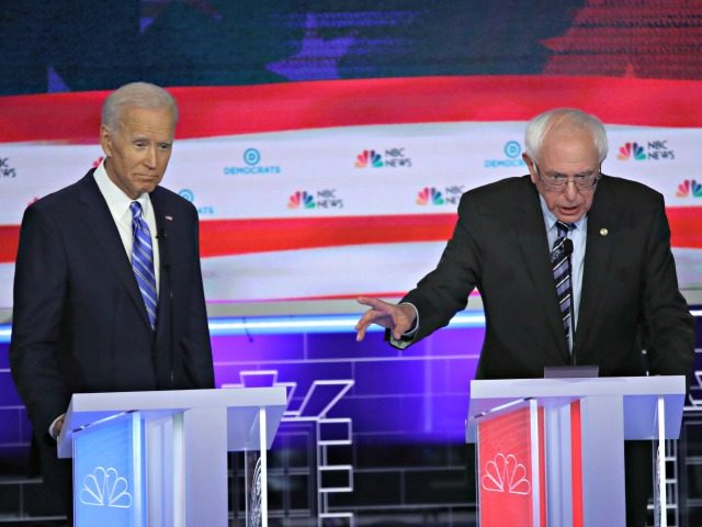 MIAMI, FLORIDA - JUNE 27: Democratic presidential candidate former Vice President Joe Biden looks on as Sen. Bernie Sanders (I-VT) speaks during the second night of the first Democratic presidential debate on June 27, 2019 in Miami, Florida. A field of 20 Democratic presidential candidates was split into two groups …