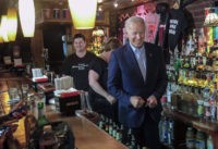 Former Vice President and 2020 Democratic presidential candidate Joe Biden, right, joins bartenders behind the counter during his visit to the Stonewall Inn, Tuesday, June 18, 2019, in New York. Biden paid a visit to the Stonewall Inn ahead of the 50th anniversary of an uprising that helped spark the …