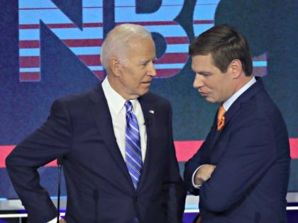 MIAMI, FLORIDA - JUNE 27: former Vice President Joe Biden and Rep. Eric Swalwell (D-CA) speak during a break in the second night of the first Democratic presidential debate on June 27, 2019 in Miami, Florida. A field of 20 Democratic presidential candidates was split into two groups of 10 …