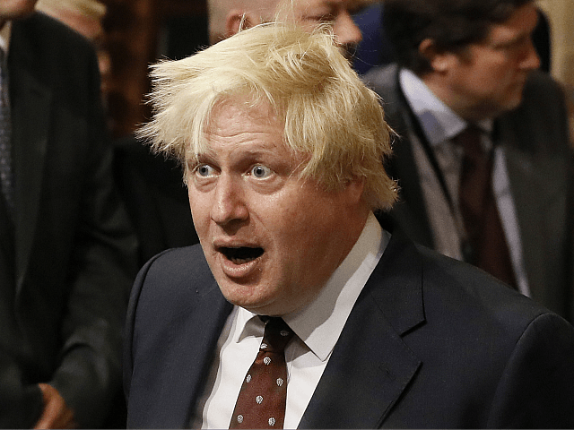 LONDON, UNITED KINGDOM - JUNE 21: British Foreign Secretary Boris Johnson walks through the House of Commons to attend the the State Opening of Parliament taking place in the House of Lords at the Palace of Westminster on June 21, 2017 in London, United Kingdom. This year saw a scaled-back …