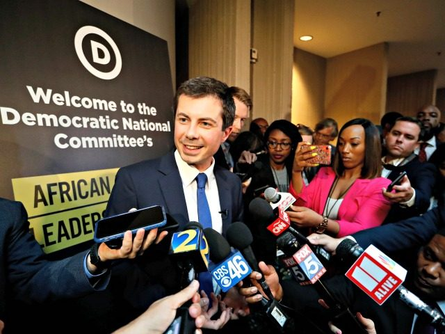 Democratic presidential candidate Pete Buttigieg talks with reporters after addressing the African American Leadership Summit Thursday, June 6, 2019, in Atlanta. (AP Photo/John Bazemore)