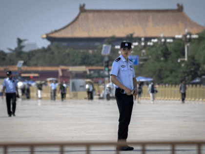 Police officers (L and front) secure Tiananmen Square in Beijing on June 3, 2019. - China will mark 30 years since the Tiananmen crackdown on June 4, 1989. (Photo by Nicolas ASFOURI / AFP) (Photo credit should read NICOLAS ASFOURI/AFP/Getty Images)