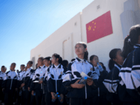 "A group of students visit ""Mars Base 1"", a C-Space Project, in the Gobi desert, some 40 kilometres from Jinchang in China's northwest Gansu province on April 17, 2019. - Surrounded by barren hills in northwest Gansu province, ""Mars Base 1"" opened to the public on April 17 with the …"