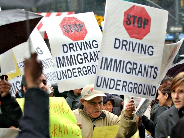 Immigrants and community leaders in New York City protest on April 13, 2004, against a state policy that denies driver's licenses to hundreds of thousands of immigrants. The protest followed a crackdown on individuals without Social Security numbers. (Getty Images/Stephen Chernin)