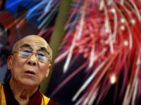 Tibetan spiritual leader The Dalai Lama looks on during his public lecture in Tabor hall in Maribor, some 150 kilometers from Ljubljana on April 6, 2010. The Dalai Lama is on the three-day unofficial visit to Slovenia during which no meeting with the country's top officials is planned. AFP PHOTO/ …