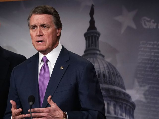 WASHINGTON, DC - FEBRUARY 12: U.S. Sen. David Perdue (R-GA) (L) speaks as Sen. Chuck Grassley (R-IA) (R) looks on during a news conference on immigration February 12, 2018 at the Capitol in Washington, DC. Senate Republican lawmakers introduced a $25 billion border security package, with limits to family-based immigration, …