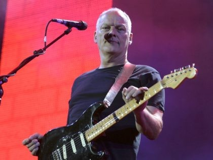 """LONDON - JULY 02: Dave Gilmour of Pink Floyd performs on stage at """"Live 8 London"""" in Hyde Park on July 2, 2005 in London, England. The free concert is one of ten simultaneous international gigs including Philadelphia, Berlin, Rome, Paris, Barrie, Tokyo, Cornwall, Moscow and Johannesburg. The concerts precede …"""